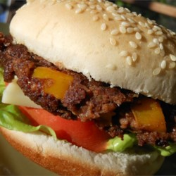 Black Bean Burgers Recipe - These black bean burgers feature the flavors of cumin, chili powder, garlic, liquid smoke flavoring, and ranch dressing mix.