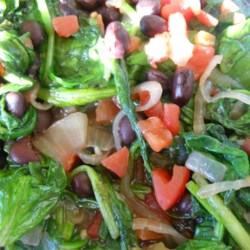 Boy, Oh Boy, Black Bean Salad  Recipe - Black beans and tomatoes are simmered with onions and garlic and then tossed with wilted spinach for a colorful side salad.