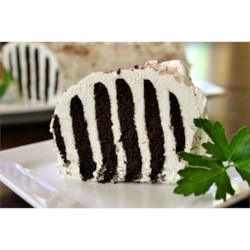Zebra Cake III Recipe - This classic icebox cake layers chocolate cookies with whipped cream to form a black and white striped cake when sliced.