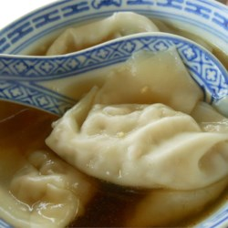 Wonton Soup With A Kick Recipe - Prepared wontons float in a broth made spicy with the addition of chile-garlic sauce in this soup recipe.