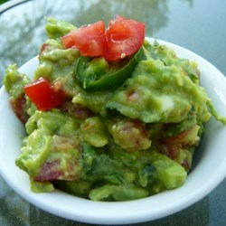 Traditional Mexican Guacamole Recipe - This guacamole uses the traditional ingredients of avocado, lemon juice, cilantro, and onion. Spice it up with jalapeno pepper if you like!
