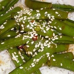 Asian Sugar Snap Pea Appetizer Recipe - Whether you start with fresh or frozen sugar snap peas, this recipe bursts with soy sauce and sesame flavor. Serve the snap peas hot as a side dish, or chilled for an Asian-inspired appetizer.