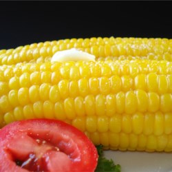 Corn On The Cob (Easy Cleaning and Shucking) Recipe - There's no need to husk and silk an ear of corn when you use this quick method for microwaving a whole ear of unhusked corn and just squeezing it out of the husk.