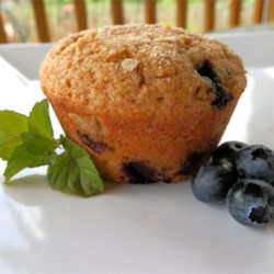 Whole Wheat Blueberry Muffins Recipe - Whole wheat flour and 2 full cups of blueberries give these hearty muffins their nutty, wholesome flavor. They take only 35 minutes from mixing ingredients to pulling from the oven.