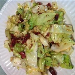 Southern Fried Cabbage Recipe - This dish was always a favorite at Mammaw's house. Cabbage is fried with onion and bacon in this simple quick side dish. Terrific with cornbread.
