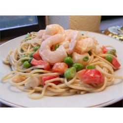 Spaghetti Salad III Recipe - Simple, pretty and delicious. Pasta, shrimp, celery, onion and peas, all tossed in a creamy ranch dressing.
