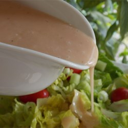 Cranberry Mustard Salad Dressing Recipe - This beautiful vinaigrette combines cranberry sauce and mustard for a light, tangy taste.
