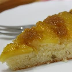 Peach Upside Down Cake I Recipe - Fresh peach halves in a nutmeg-spiced sauce top this buttery upside down cake. Serve with whipped cream.