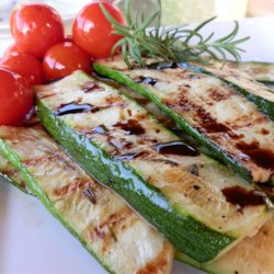 Grilled Zucchini Recipe - Long strips of zucchini are basted with a rosemary-accented olive oil mixture and cooked on the grill in this recipe.