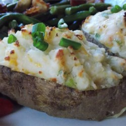 Healthier Ultimate Twice Baked Potatoes Recipe - These healthier twice baked potatoes are filled with lower fat versions of sour cream and milk.