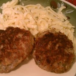 Swabian Meatballs (Fleischkuechle) Recipe - These German meat patties use both ground beef and ground pork seasoned with marjoram, parsley, onion, and garlic and are fried in butter.