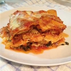 Alysia's Basic Meat Lasagna Recipe - A very meaty and cheesy lasagna with mozzarella, Provolone, ricotta and Parmesan cheese layered with red sauce, browned beef and herbs.