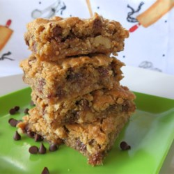 Milly's Oatmeal Brownies  Recipe - These are wonderful, chewy blondies that are made with oatmeal instead of chocolate. Add your favorites (nuts, chocolate chips, chocolate candies, toffee chips) and create a truly delicious treat.