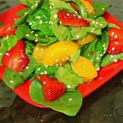 Strawberry Spinach Salad III Recipe - Dill is sprinkled on the strawberries and spinach before being tossed in a robust and sweet vinegar and oil dressing laced with hot mustard, onion and garlic powder, and a pinch of cayenne.