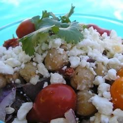 Mediterranean Chickpea Salad I Recipe - Chickpeas, sun-dried tomatoes, and feta cheese are the stand-out ingredients in this easy and remarkably flavorful chilled salad.