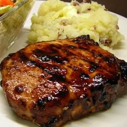 Grilled Mongolian Pork Chops Recipe and Video - These sweet and tangy grilled pork chops are marinated in a flavorful combination of peppers and spices.