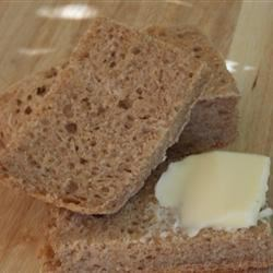 Milwaukee Rye Bread Recipe - This is a vintage recipe for a hearty loaf, mixing rye, whole wheat and cornmeal.  Freshly mashed potatoes lighten up the texture.