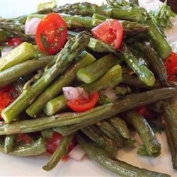 Green Bean and Asparagus Salad Recipe - This very tasty salad of roasted asparagus and green beans with of cherry tomatoes, onion, and fresh parsley also presents with lovely color.