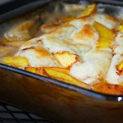Peach Cobbler III Recipe - This yummy cobbler uses canned instead of fresh peaches, and there 's nary a difference. The light and airy biscuit batter goes in the pan first, followed by the peaches. It bakes up bubbly and delicious and is grand with scoops of vanilla ice cream.