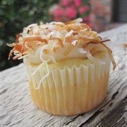 Toasted Coconut Cream Cake  Recipe - A package of white cake mix gets special treatment, and makes a richly flavored frosted coconut layer cake with a toasted coconut topping.