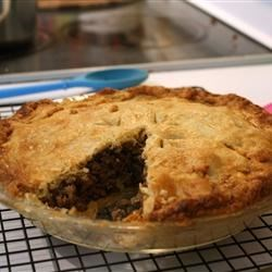 Reveillon Tourtiere Recipe - This savory pork pie is filled with cooked ground pork, sliced mushrooms, celery, fresh bread crumbs, and lots of herbs and spices.