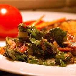 Pan Fried Swiss Chard Recipe - Garlic paste, lemon juice, and bacon provide a lot of flavor for this Swiss Chard side dish.