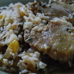 Mango Chicken Bake Recipe - The combination of mango, ginger, and cilantro give this baked chicken and rice dish a fresh, sweet taste.