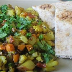 Indian Vegetable Bhaji Recipe and Video - In this Indian dry curry, potatoes, cauliflower, carrots and peas are fried and flavored with spices, garlic, and chiles. It's perfect as a side dish for an Indian dinner.