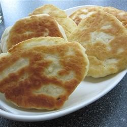 Bannock Recipe - This basic bread can cook conventionally on a baking sheet in your oven, or try it stovetop in a skillet.  Raisins perfectly complement it.