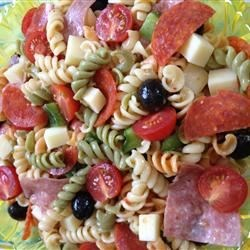 Awesome Pasta Salad Recipe - This pasta salad  - made with Provolone, salami, pepperoni, bell peppers, and black olives tossed with fusili pasta and Italian salad dressing - is very easy to make, AND can be prepared in 45 minutes or less.
