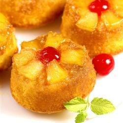 Pineapple Upside Down Cupcakes Recipe - The pretty topping of golden pineapple with a red cherry is great for cupcakes! These cupcakes are made with pineapple cake mix, crushed pineapple, and brown sugar.