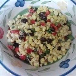 Spicy Corn and Black Bean Salad Recipe - Corn kernels pan-fried with fajita seasoning are tossed with black beans, jalapeno, and lime and orange juice for a tangy and spicy salad.