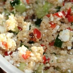 Couscous and Cucumber Salad Recipe - This is a beautiful cold salad that's refreshing and delicious.  Couscous is combined with lemon, cucumber, green onions, parsley and basil, and is served on a bed of lettuce.
