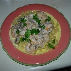 Shrimp & Scallop Stroganoff Recipe - Elegant comfort food, this delicious seafood sauce with tender shrimp and scallops is simple to prepare and perfect for a dinner party! Serve with egg noodles or white rice.