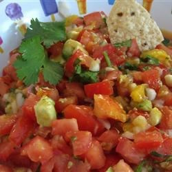 Mango Avocado Salsa Recipe - Tomatoes, mango, avocado, and jalapeno peppers combine for a salsa great for dipping or serving over fish.