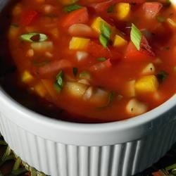Fresh Market Gazpacho Recipe - A yummy summer soup for when it's just too hot to cook! The garbanzo beans and vegetables make this soup very filling.