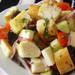 Panzanella Salad (Bread Salad) Recipe - Kalamata olives add a mouthwatering flavor to this classic Italian bread salad with fontina cheese, tomatoes, and cucumber.