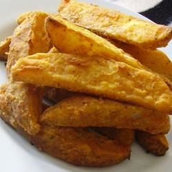 Mojo French Fries Recipe - Oven-baked potato wedges coated in flour with spicy seasonings are a nice alternative to French fries.