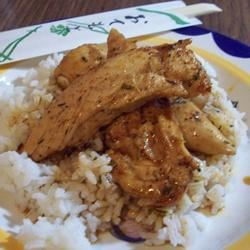 Herbed Sweet 'n' Sour Chicken Recipe - Chicken breasts basted with a tangy, herb-enhanced sweet and sour sauce are served over hot rice.