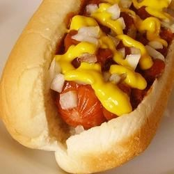 Detroit-Style Coney Dogs Recipe - Fire up the grill and put together baseball-style hot dogs inspired by the classic Detroit Coney. Topped by onions, warmed chile sauce, and mustard, every meaty bite will take you out to the ballgame.