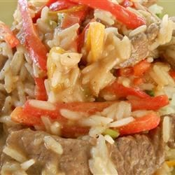 Pepper Rice and Confetti Beef Recipe - Sauteed bell peppers and seasoned beef sirloin, with Dijon mustard and honey. Served over rice with green onion.