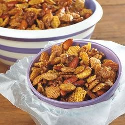 Caramel Snack Mix Recipe - Blend butter with cereal and toasted nuts to make this sweet cocktail munchie that disappears by the handful.