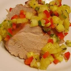 Pork Tenderloin with Pineapple Salsa Recipe - Fresh pineapple, peppers, and cilantro bring a bright and summery flavor to this pork tenderloin. Though it's great in the summer, try it all year round.