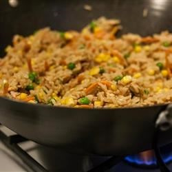 Chinese Chicken Fried Rice II Recipe and Video - Cooked egg is shredded and mixed with a stir fry of chicken, rice and onion in soy sauce in this fundamental Chinese dish.