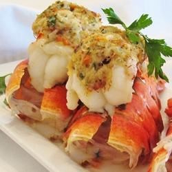 Crab-Stuffed Lobster Tail Recipe - Lobster tails topped with crab dressing make an exquisite but surprisingly simple meal for two. Serve with fresh lemon wedges.