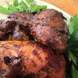 Pontevedra-Style Spanish Chicken Recipe - This simply delicious chicken is roasted in a sauce of olive oil, butter, roasted garlic, and Spanish paprika. The garlic-butter and oil sauce is served on the side for dipping.