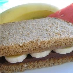 Chocolate Almond Sandwich Recipe - Everyone will love this simple treat - Nutella(r), a chocolate hazelnut spread, with almond butter and sliced bananas between slices of bread. It just proves you can have chocolate almost any time with almost anything.