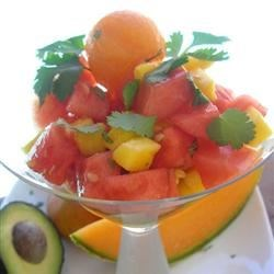 Melon, Mango, and Avocado Salad Recipe - Tangy pickled onions and creamy avocados add a surprisingly savory bite to this crisp fruit salad. When served in a pretty martini glass, it makes a stunning first course.