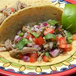 Pork Carnitas Recipe and Video - Pork shoulder is braised until very tender, then finished in the oven to produce a delicious filling for tortillas.