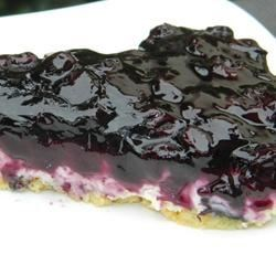 Meyer Lemon and Blueberry Cheese Tart Recipe - A creamy mascarpone and lemon curd filling is topped with a fresh blueberry sauce in this summery dessert.